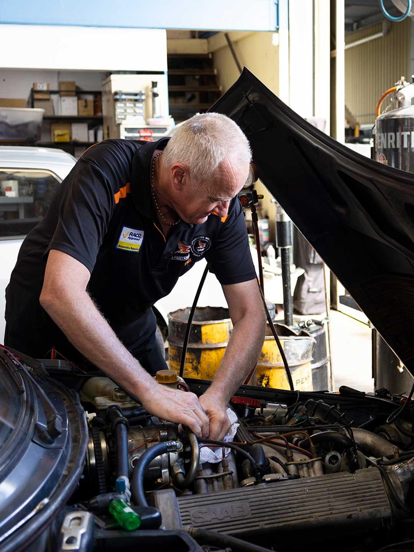 Paul Bird working in a car engine